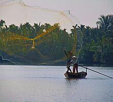 Vietnam. Hoi An River. Fisherman Throwing a Net. by vadim19