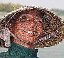 Vietnam. Hoi An River. Portrait of a Fisherman. by vadim19