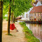 A couple laze in a hammock in Bruges by Elana Bailey