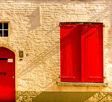A red door and shutters in Bruges by Elana Bailey