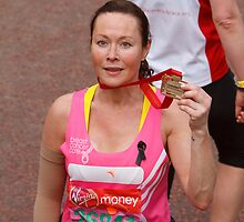 Amanda Mealing after finishing the London Marathon 2013 by Keith Larby