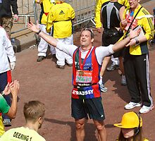 Andrew Strauss celebrating after finishing the London Marathon by Keith Larby