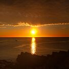 Sailboat and Sunrise over Ocean  by KellyHeaton