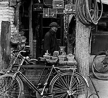 A Bicycle Repair Shop by Janos Sison