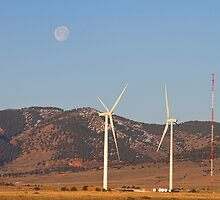 Wind Turbines with a Full Moon and Blue Skies by Bo Insogna