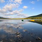 Wooden boats on the mountain lake by DmiSmiPhoto