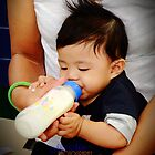 Baby boy & his milk by JhaMesPhotos