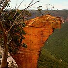 Hanging Rock with wooden frame by Michael Matthews