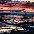 Pinks, blues, sky, rocks, sea by KittieEmpire