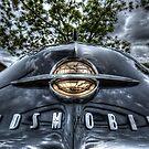 HDR - Old Olds Badge by Doug Greenwald