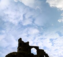 Mow cop castle on rocks in silhouette by morrbyte