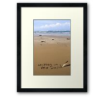 it's written in the sand on a beach Framed Print