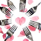 forks surrounding heart shape with rose petals by morrbyte