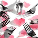 stylish forks surrounding heart shape and rose petals by morrbyte