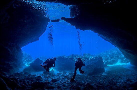 Inside looking Out - Divers in a Cave by Karen Willshaw