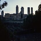 San Gimignano towers against evening sky 198403140048 by Fred Mitchell
