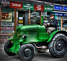 Vintage tractor on market day by PhotoStock-Isra