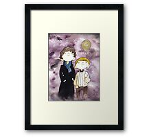 Sherlock and John and a yellow smile balloon Framed Print