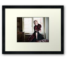 Victorian woman in library Framed Print