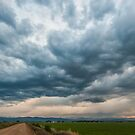 Storm Clouds on The Road Home by Greg Summers