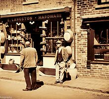 Chatting Outside the Hardware Store by David J Knight