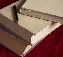 pencil and three books by slavikostadinov