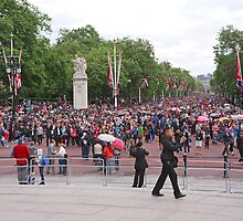 Crowds walk down the mall after Trooping The Colour to watch the Royals on the balcony by Keith Larby