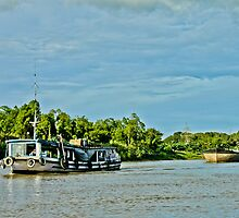 Indonesian traditional boat for sand at Mahakam River Melak West Kutai East Borneo by PutroGraph