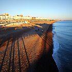 Brighton Beach & Pier Shadow by plcimages