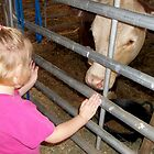 My Friends daughter Meets Her First Cow by WildestArt