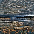 Leopard sky/water by Kip Nunn