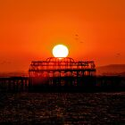 Sunset Over the Remains Of The West Pier by Chris Lord