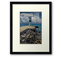 Lighthead at the end of the pier in Pentwater Michigan Framed Print