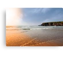 surfers near cliffs at sunset Canvas Print