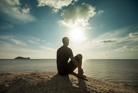 Man Watching Sunset by the Ocean by visualspectrum