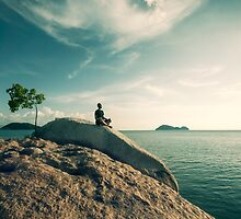 Man Meditating By The Ocean by visualspectrum