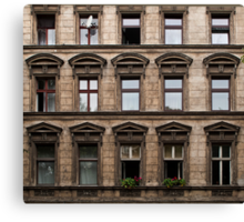 Facade of an old grey building in East Berlin Canvas Print