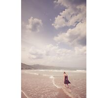 Girl Walking Along a Beach Photographic Print