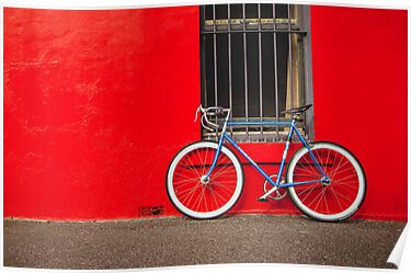 Fixed Gear (Fixie) Bicycle Against a Red Wall by jamjarphotos