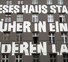 Capital letters writing on the facade of a Berlin building  by Reinvention