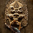TIBETAN DOOR KNOCKER WITH FEATHER by Larry Butterworth