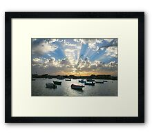 Boats on the sea and rays of light  Framed Print