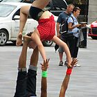 Street acrobats by Mike Shell