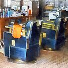 Barber Chair With Orange Barber Cape by Susan Savad