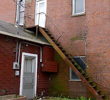 Rusty Stairs on the  Red Boarding  House by WildestArt