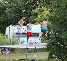 boys jumping on trampoline by karencadmanfoto