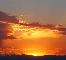 Fiery Sunset over the Rocky Mountains by Amy McDaniel