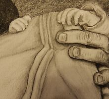 Father and newborn hold hands by Dan Wagner