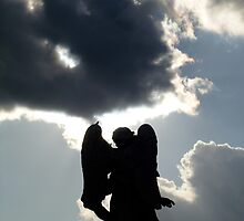 Angel statue silhouetted against stormy sky. by Colin Tester