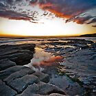 Sunset and Rock Pools on the beach by Heidi Stewart